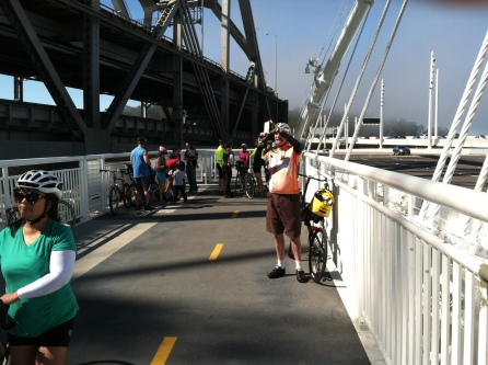 Sam taking a photo at the current endpoint of the bike trail / Photo by Ilana DeBare