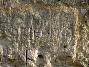 Graffiti near entrance to St. Emilion's cave from 1767 / Photo by Ilana DeBare